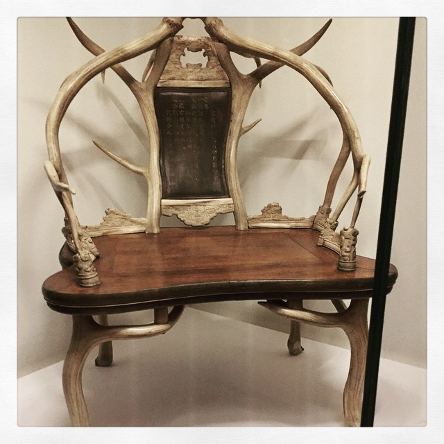 a chair made out of antlers and other horrifying things