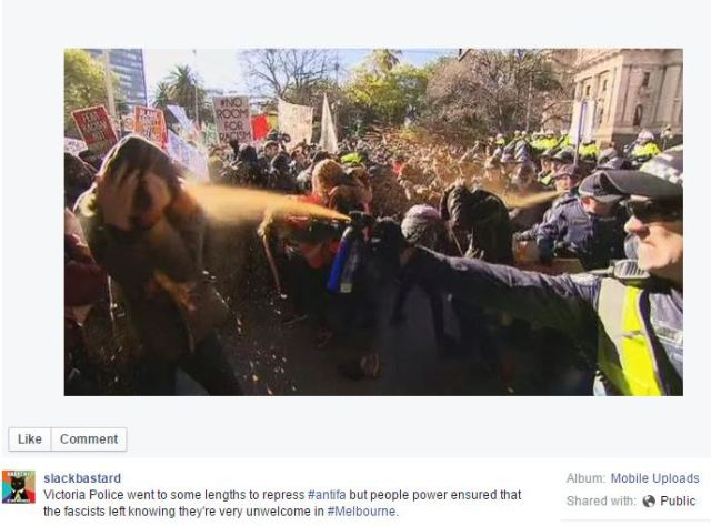 copper pepper spraying a protester; fb text: victoria police went to some lengths to repress #antifa but people power ensured that the fascists left knowing they're very unwelcome in #Melbourne
