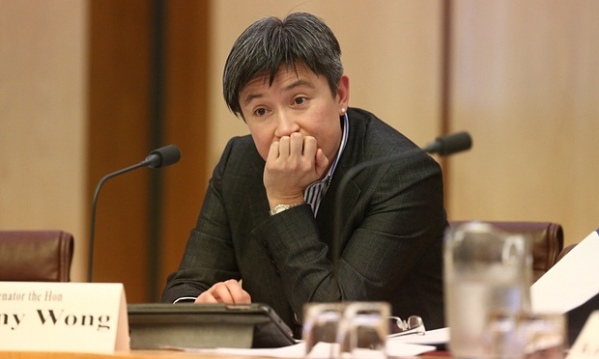 Picture of Penny Wong in question time, chin in balled-up hand, wearing an expression of doubt, irritation and confusion. This picture is going to come up a lot.