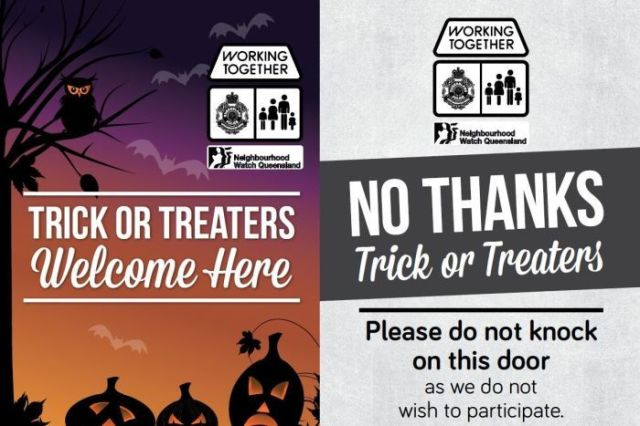 Posters either welcoming trick or treaters or warning them the house does not participate.