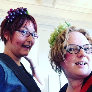 liz and steph wearing grape fascinators