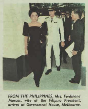 Imelda Marcos wearing a shockingly 80s-tastic dress.  Think big shoulders.  She looks like she wandered off the set of Dynasty.