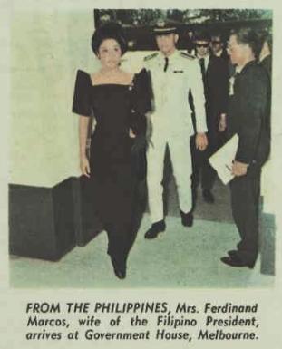 Imelda Marcos wearing a shockingly 80s-tastic dress.  Think big shoulders.  She looks like she wandered off the set of Dynasty.