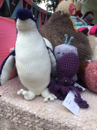 A knitted penguin and octopus hanging out.