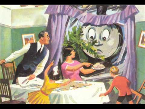 "Illustration from ""Thomas Comes to Breakfast"": Thomas the Tank has crashed through a house into a room where a family (white, straight, 2.5 children) are eating breakfast. The wife is gesturing angrily at her ruined meal."