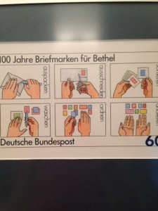 a stamp with illustrations demonstrating how to engage in philately