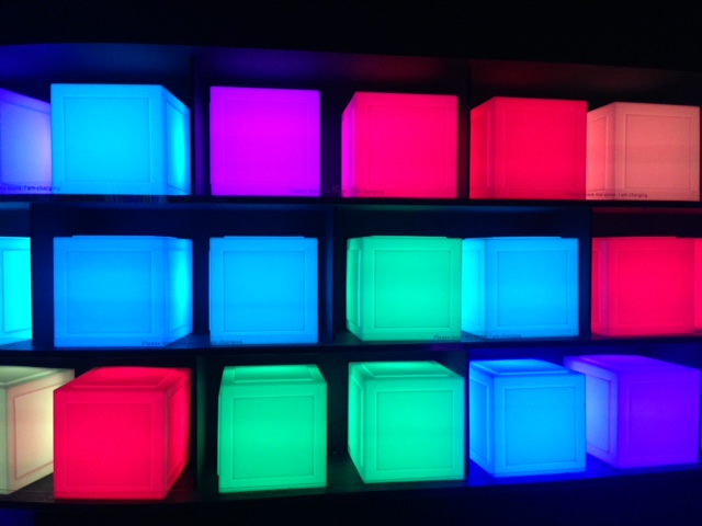 glowing boxes in a charging station