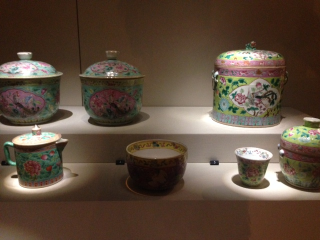 collection of pots, kettles and crockery with traditional peranakan flower patterns