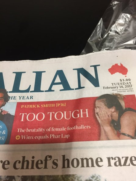 Preview for a feature, headlined: TOO TOUGH: The brutality of female footballers, with an image of an AFLW player hiding her face in her hands.