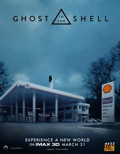 Image: A woman in white with long, black hair stands atop a Shell service station. The rest of the image is the logo and tagline for the Ghost in the Shell film.
